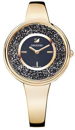 Crystalline pure montre feminine de Swarovski avec un bracelet en acier fin dore et un cadran noir