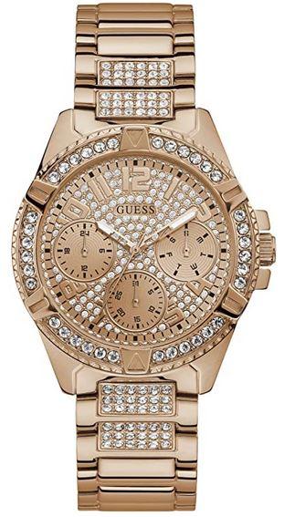 Montre Guess pour femme effet grand luxe en acier dore et incrustee de pierres precieuses