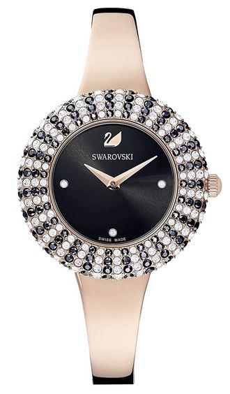 Swarovski crystal rose montre pour femme avec un bracelet couleur or rose tres et un cadran noir entoure de pierres brillantes