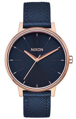 montre Nixon pour femme avec bracelet en cuir bleu boitier et aiguilles rose gold et cadran bleu