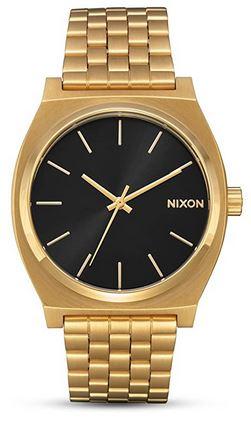montre analogique a quartz pour femme avec bracelet dore et cadran noir de la marque Nixon
