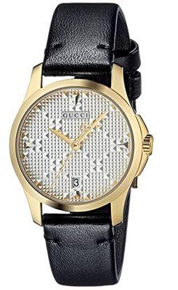 montre femme de Gucci avec bracelet en cuir lisse noir boitier dore et cadran blanc a relief