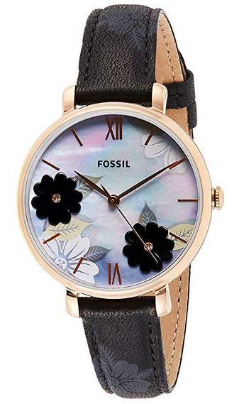 montre femme marque Fossil cadran fleurs et bracelet en cuir noir avec fleurs imprimees