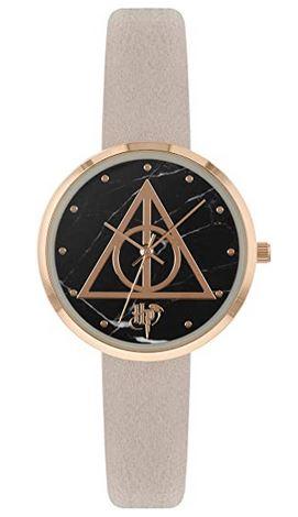 montre analogique a quartz de la saga Harry Potter les reliques de la mort avec un bracelet violet pale en cuir ainsi quun boitier dore en acier