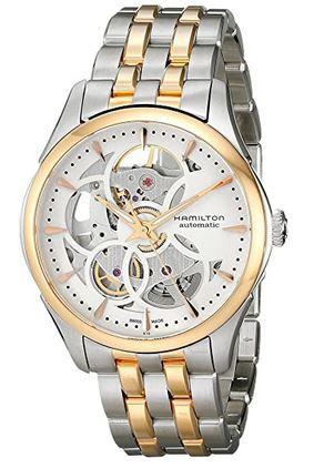 montre de luxe feminine de la marque suisse Hamilton modele avec mecanisme apparent et bracelet en acier couleur or et argent