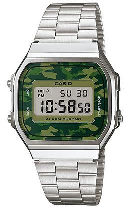 montre digitale Casio pour femme avec un cadran militaire camouflage vert fonce ainsi quun bracelet en acier couleur argent