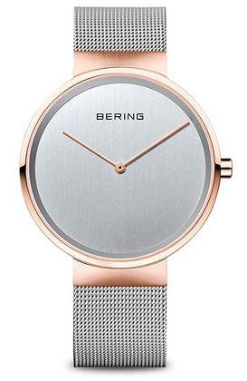 montre vintage a quartz destinee aux femmes de la marque Bering modele minimaliste avec a maille fine argentee et boitier rose gold