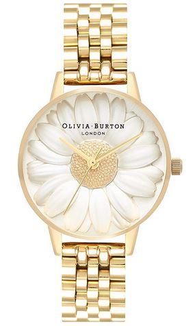 montre doree et originale avec une marguerite qui recouvre le cadran de la marque Olivia Burton pour femme