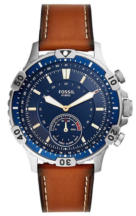 montre Fossil connectee modele hybride Garrett FTW1191 avec un bracelet marron fonce lisse un boitier argente en acier et un cadran bleu marine compatible android et iphone