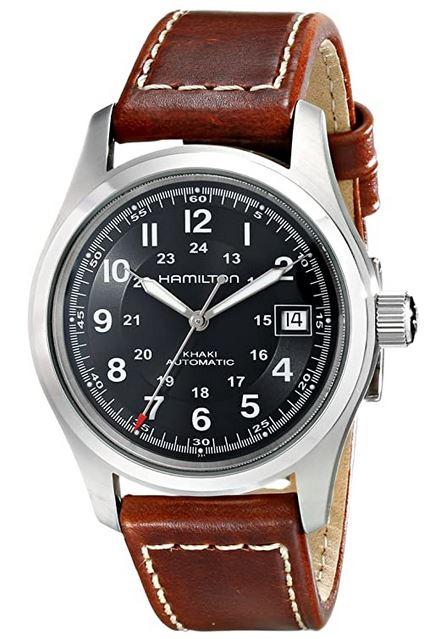 montre destinee aux hommes de la marque suisse Hamilton modele Automatic Khaki avec un cadran sur fond noir et bracelet en cuir marron